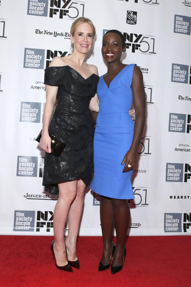 """NEW YORK, NY - OCTOBER 08: Actress Sarah Paulson (L) and Actress Lupita Nyong'o attend the """"12 Years A Slave"""" premiere during the 51st New York Film Festival at Alice Tully Hall at Lincoln Center on October 8, 2013 in New York City. (Photo by Jemal Countess/Getty Images)"""