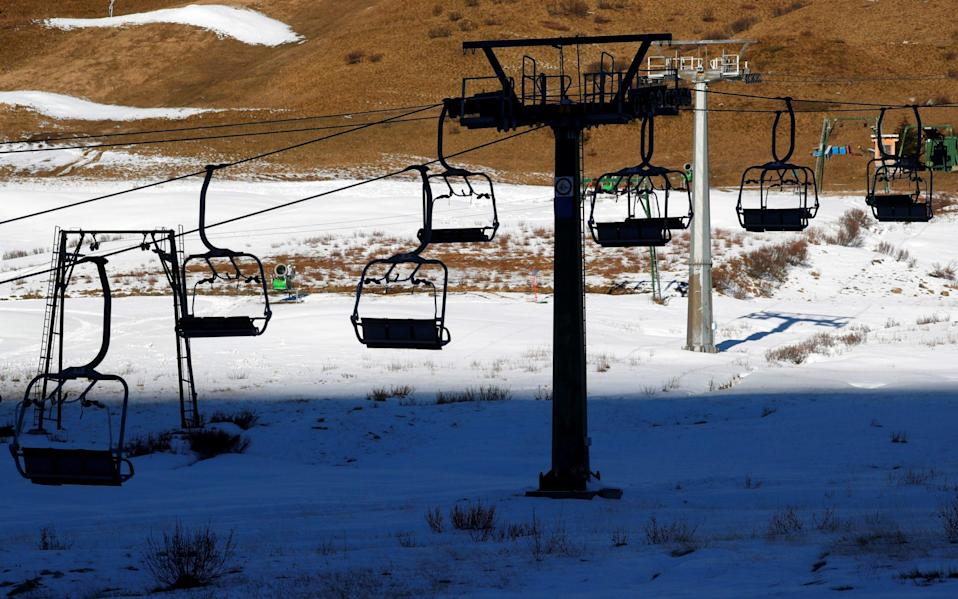 A closed chairlift is seen at the ski resort of Passo Tonale in the Dolomites which has become a virtual ghost town - Getty
