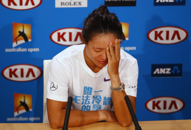 Li Na of China attends a news conference after being defeated by Victoria Azarenka of Belarus in their women's singles final match at the Australian Open tennis tournament in Melbourne, January 26, 2013. REUTERS/Navesh Chitrakar (AUSTRALIA - Tags: SPORT TENNIS) - RTR3CZCR