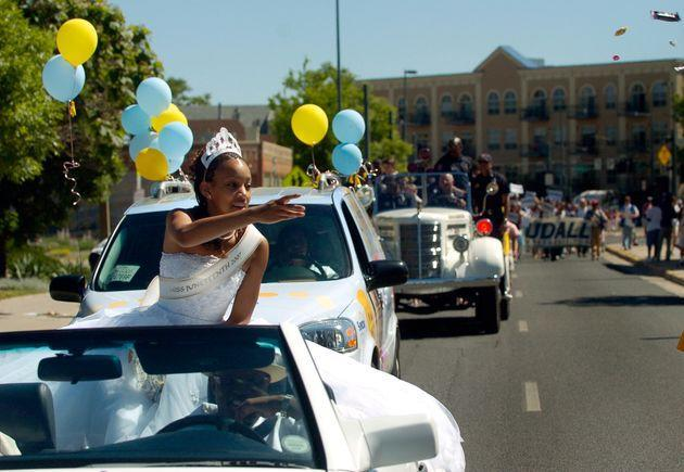 Denver's Miss Juneteenth 2007 Rebekah Johnson, 17, throws candy to some of the kids watching the parade. (Photo: Kathryn Scott Osler via Getty Images)