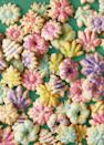 """<p>Get creative with the colors: You can dye the dough itself or just have fun with sprinkles and sanding sugar. Decorate before you bake.</p><p>Get the recipe from <a href=""""https://www.delish.com/cooking/recipe-ideas/a37447711/spritz-cookies-recipe/"""" rel=""""nofollow noopener"""" target=""""_blank"""" data-ylk=""""slk:Delish"""" class=""""link rapid-noclick-resp"""">Delish</a>.</p>"""