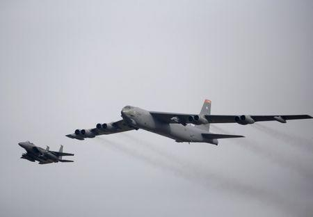 FILE PHOTO: A U.S. Air Force B-52 (R) flies over Osan Air Base in Pyeongtaek, South Korea, January 10, 2016. REUTERS/Kim Hong-Ji