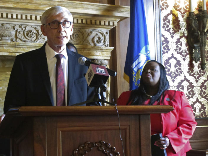 Wisconsin Gov. Tony Evers speaks during a news conference as Democratic state Rep. Sheila Stubbs listens Monday, May 20, 2019, in Madison, Wis. George Floyd's killing last year and the protests that followed led to a wave of police reforms in dozens of states, from changes in use-of-force policies to greater accountability for officers. At the same time, lawmakers in a handful of states have had success addressing racial inequities. Evers, a Democrat, on Wednesday, April 21, 2021 ordered the Wisconsin State Patrol and other state law enforcement agencies to update their use-of-force policies to prohibit chokeholds, unless as a last resort. (AP Photo/Scott Bauer)