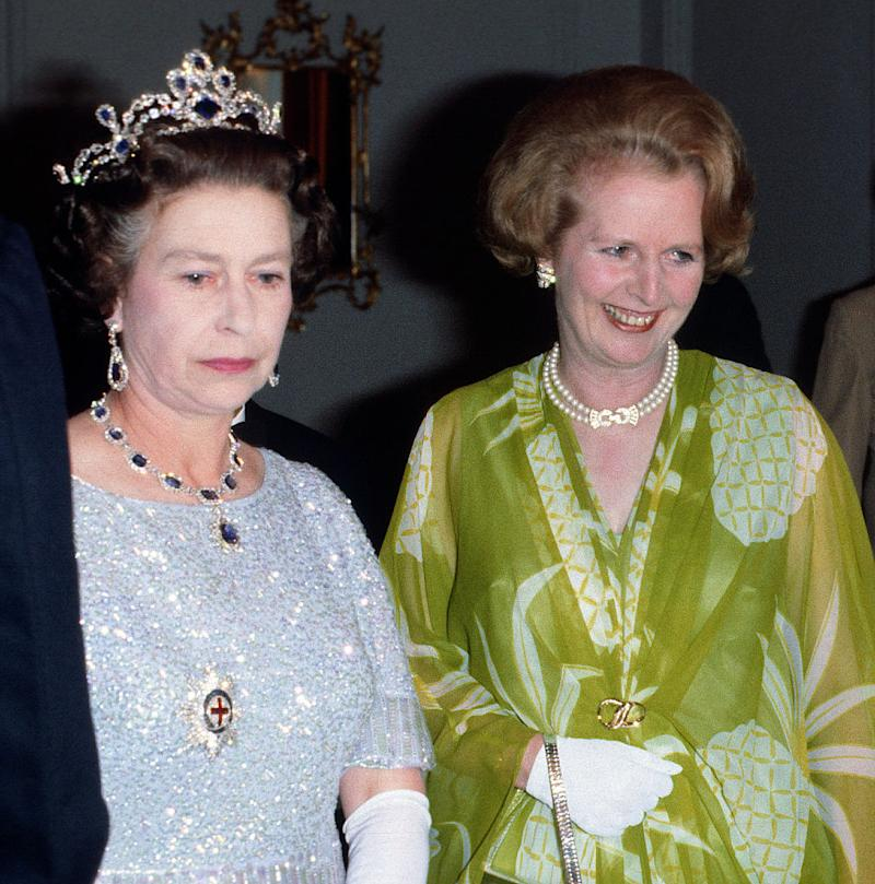 LUSAKA, ZAMBIA - AUGUST 01: Queen Elizabeth II and Prime Minister Margaret Thatcher attend a ball to celebrate the Commonwealth Heads of Government Meeting hosted by President Kenneth Kaunda on August 01, 1979 in Lusaka, Zambia. (Photo by Anwar Hussein/Getty Images)