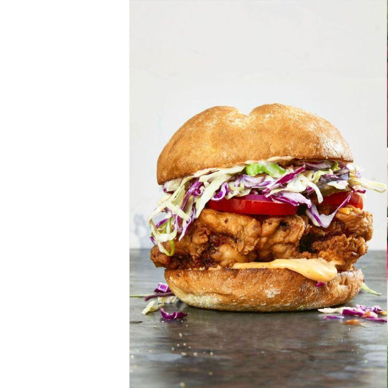 """<p>We're already drooling over these sandwiches, featuring a heaping portion of coleslaw and crispy chicken sandwiched between a brioche bun.</p><p><em>Get the recipe from <a href=""""https://www.goodhousekeeping.com/food-recipes/easy/a36261/ultimate-fried-chicken-sandwiches/"""" rel=""""nofollow noopener"""" target=""""_blank"""" data-ylk=""""slk:Good Housekeeping"""" class=""""link rapid-noclick-resp"""">Good Housekeeping</a>.</em></p>"""