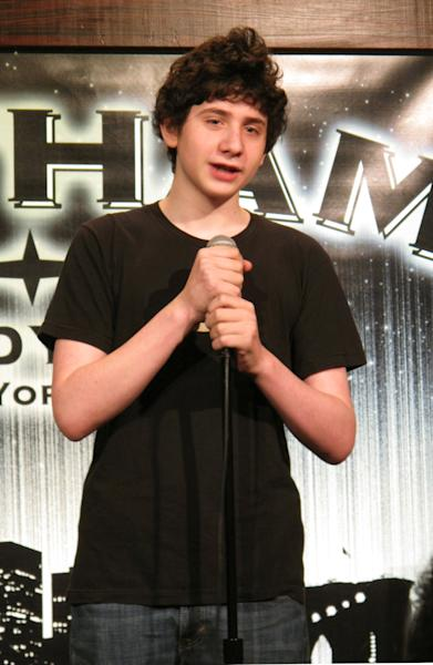 """In this Dec. 16, 2012 photo, 14-year-old comedian Zach Rosenfeld performs his stand-up routine during the """"Kids 'N Comedy"""" show at Gotham Comedy Club in New York. Children can get grownup laughs at a monthly comedy show in Manhattan where homework, parents and the awkwardness of adolescence rule the stage. (AP Photo/Larry Neumeister)"""