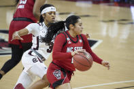 North Carolina State guard Raina Perez drives next to South Carolina guard Destanni Henderson (3) during the first half of an NCAA college basketball game Thursday, Dec. 3, 2020, in Columbia, S.C. N.C. State won 54-46. (AP Photo/Sean Rayford)