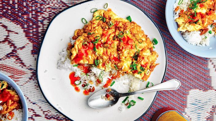 """""""If you know me, you know (and are probably irritated by) how much I love to wax poetic about the places I <em>used</em> to live: namely, Chiang Mai, Thailand, and Atlanta, Georgia. This crispy, fluffy, fish-sauce-kissed <a href=""""https://www.bonappetit.com/recipe/khai-jiao?mbid=synd_yahoo_rss"""" rel=""""nofollow noopener"""" target=""""_blank"""" data-ylk=""""slk:Thai omelet"""" class=""""link rapid-noclick-resp"""">Thai omelet</a> from chef Parnass Savang at Atlanta's <a href=""""https://talatmarketatl.com/"""" rel=""""nofollow noopener"""" target=""""_blank"""" data-ylk=""""slk:Talat Market"""" class=""""link rapid-noclick-resp"""">Talat Market</a> transports me back to both of these long-lost happy places—and it's incredibly easy to make, even in my tiny Brooklyn kitchen."""" —<em>Hilary Cadigan, culture editor</em> <a href=""""https://www.bonappetit.com/recipe/khai-jiao?mbid=synd_yahoo_rss"""" rel=""""nofollow noopener"""" target=""""_blank"""" data-ylk=""""slk:See recipe."""" class=""""link rapid-noclick-resp"""">See recipe.</a>"""