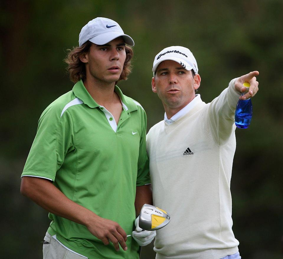 <p>Rafael Nadal gets directions from Sergio Garcia during the Castello Masters Costa Azahar at the Club de Campo del Mediterraneo in October 2008.</p>