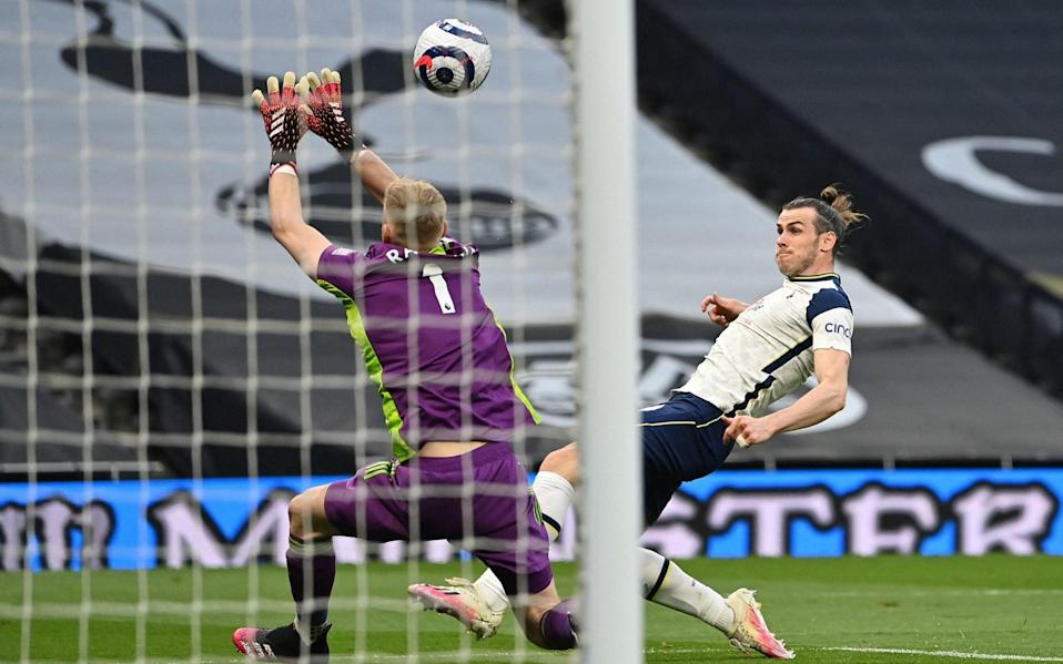 Gareth Bale nicks the ball past Aaron Ramsdale to make it 1-0 - AFP