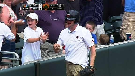 Minnesota Twins ball boy, the little brother of a big leaguer, makes a sensational leaping catch