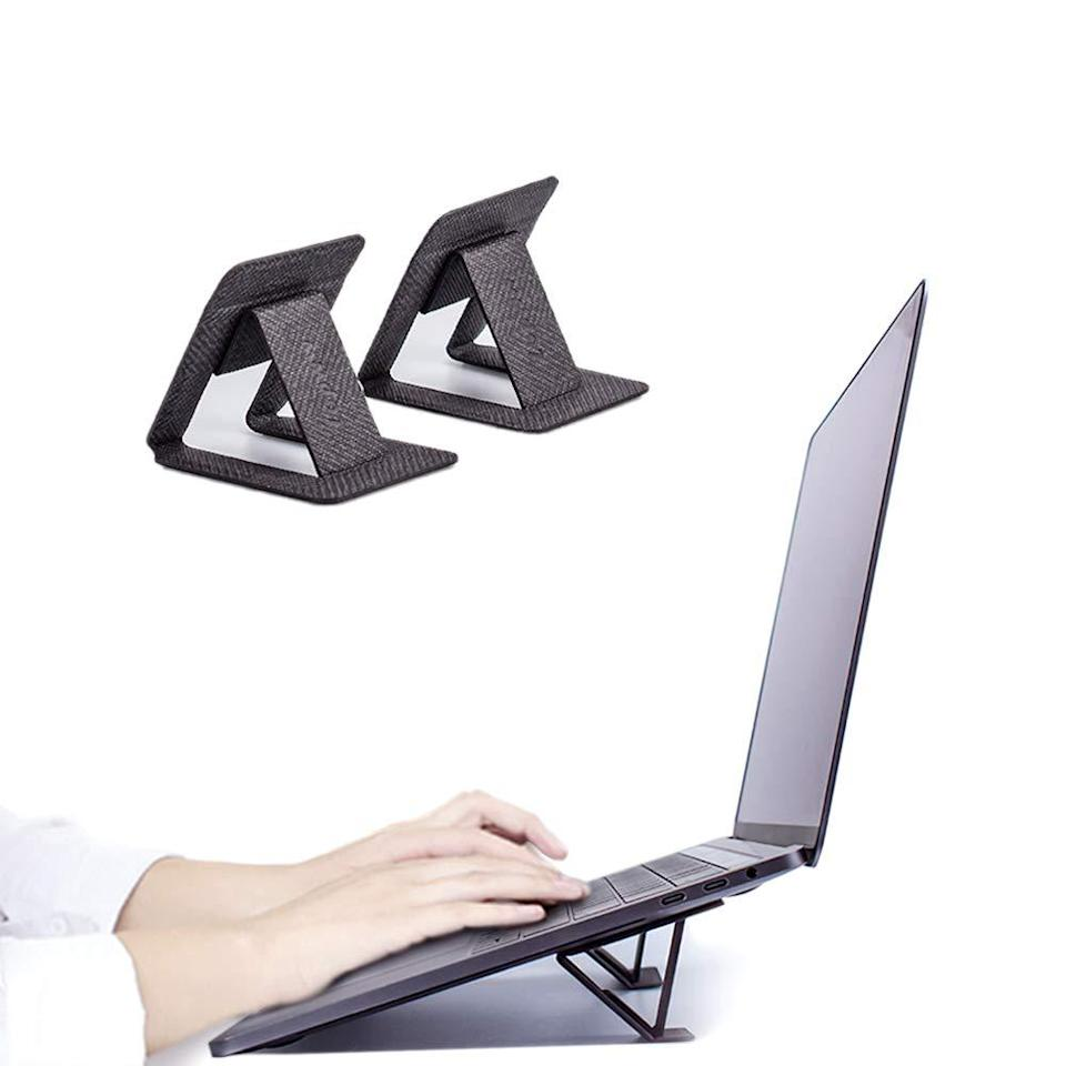 "<h2>Amazon Laptop Stand</h2><br>""This was another pain-induced purchase. I've been working from my laptop (like so many others) and I think the constant crouching and looking downward has contributed to my neck/shoulder situation. I bought these little feet that stick onto the bottom of your laptop to tilt it in more of an ergonomic way. The nice thing is they fold under when you want your laptop to lay flat again."" <em>– Kate Spencer, Creative & Updates Editor</em><br><br><em>Shop <strong><a href=""https://amzn.to/3cO2i1M"" rel=""nofollow noopener"" target=""_blank"" data-ylk=""slk:Amazon"" class=""link rapid-noclick-resp"">Amazon</a></strong></em><br><br><strong>Lopww</strong> Reusable 3M Adhesive Laptop Stand, $, available at <a href=""https://amzn.to/3cO2i1M"" rel=""nofollow noopener"" target=""_blank"" data-ylk=""slk:Amazon"" class=""link rapid-noclick-resp"">Amazon</a>"