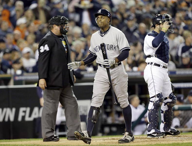 New York Yankees' Curtis Granderson reacts after striking out in the third inning during Game 3 of the American League championship series against the Detroit Tigers Tuesday, Oct. 16, 2012, in Detroit. (AP Photo/Paul Sancya )