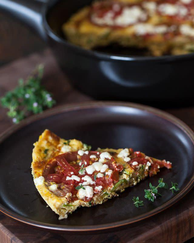 "<strong>Get the <a href=""http://www.steamykitchen.com/21513-zucchini-frittata-recipe.html"" rel=""nofollow noopener"" target=""_blank"" data-ylk=""slk:zucchini frittata recipe"" class=""link rapid-noclick-resp"">zucchini frittata recipe</a> by Steamy Kitchen.</strong>"