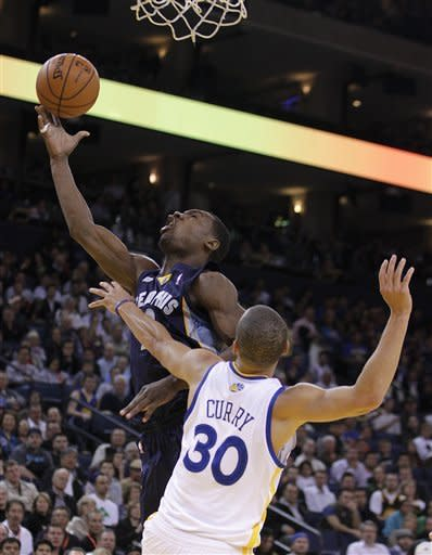 Memphis Grizzlies' Tony Allen lays up a shot over Golden State Warriors' Stephen Curry (30) during the second half of an NBA basketball game Wednesday, March 7, 2012, in Oakland, Calif. (AP Photo/Ben Margot)