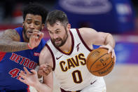 Cleveland Cavaliers forward Kevin Love (0) drives as Detroit Pistons forward Saddiq Bey defends during the first half of an NBA basketball game, Monday, April 19, 2021, in Detroit. (AP Photo/Carlos Osorio)