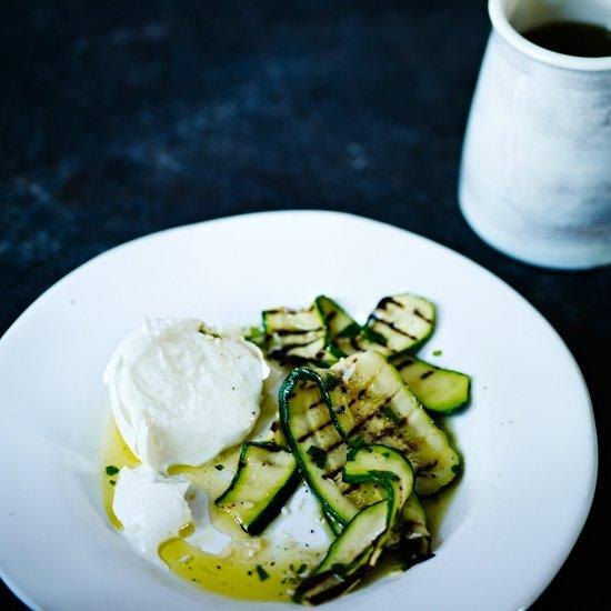 """<p>The delicate taste of fresh mozzarella offers a delicious counterpoint to the garlic-and-vinegar-macerated zucchini. However, if you prefer a stronger cheese flavor, try goat cheese instead.</p><p><a href=""""https://www.foodandwine.com/recipes/grilled-zucchini-with-fresh-mozzarella"""">GO TO RECIPE</a></p>"""