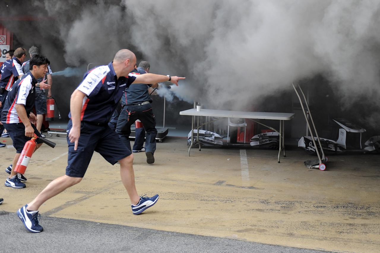 Racing team crews use a fire hose to try and extinguish a fire in the Williams racing pit stand at the Circuit de Catalunya on May , 2012 in Montmelo on the outskirts of Barcelona after the Spanish Formula One Grand Prix.   AFP PHOTO / JOSEP LAGOJOSEP LAGO/AFP/GettyImages
