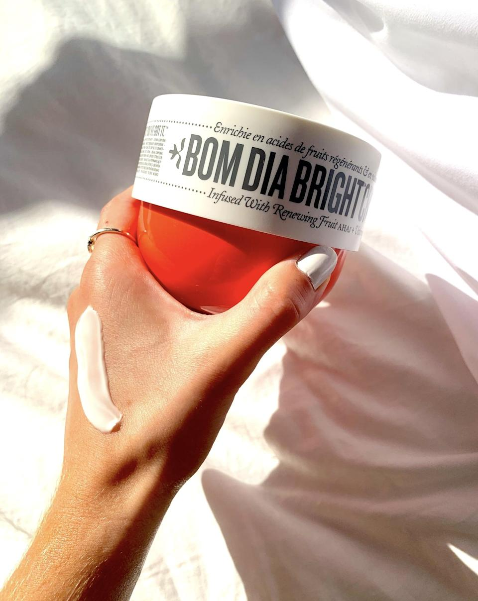 """<p>""""First and foremost, the <span>Sol de Janeiro Bom Dia Bright Body Cream</span> ($45) soaks into skin in seconds and provides a dewy, velvety finish. Similar to how a Listerine breath strip melts onto your tongue and leaves behind a nose-tingling effect, the Bom Dia follows suit. As for the nitty-gritty, this vitamin-C-infused cream visibly brightens the skin while the fatty acids in the cupuaçu butter provide lasting hydration. The cream is also infused with fruit AHAs, which help to gently exfoliate the skin's texture, meaning that after just one use, you'll feel soft and supple."""" - Lauren Harano, editorial assistant, Living </p> <p>If you want to read more, here is the <a href=""""https://www.popsugar.com/beauty/sol-de-janeiro-bom-dia-bright-body-cream-review-48277417"""" class=""""link rapid-noclick-resp"""" rel=""""nofollow noopener"""" target=""""_blank"""" data-ylk=""""slk:complete Sol de Janeiro Bom Dia Bright Body Cream review"""">complete Sol de Janeiro Bom Dia Bright Body Cream review</a>.</p>"""