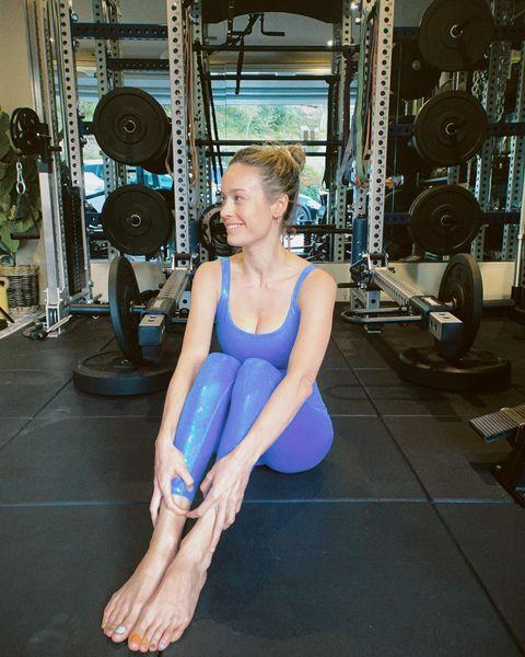 """<p>Your next workout is only as good as your recovery – trust us on that. Getting proper rest is tantamount to keep your nervous system happy and healthy, as well as give your muscles time to recover post-workout. Gym-lover Brie knows its worth so much that she made a YouTube video about it.</p><p>Explaining that due to her almost everyday training schedule, she's taking recovery more seriously than ever. Currently, her line-up includes using her <a href=""""https://www.womenshealthmag.com/uk/gym-wear/tech/a29336731/theragun/"""" rel=""""nofollow noopener"""" target=""""_blank"""" data-ylk=""""slk:Theragun"""" class=""""link rapid-noclick-resp"""">Theragun</a>, a muscle roller (<strong>different </strong>from a foam roller), a Venom heating and vibrating pad, as well as stretching and <a href=""""https://www.womenshealthmag.com/uk/fitness/yoga/"""" rel=""""nofollow noopener"""" target=""""_blank"""" data-ylk=""""slk:Yoga"""" class=""""link rapid-noclick-resp"""">Yoga</a>.</p><p>How to know <a href=""""https://www.womenshealthmag.com/uk/fitness/a705624/when-to-take-a-rest-day/"""" rel=""""nofollow noopener"""" target=""""_blank"""" data-ylk=""""slk:when to take a rest day"""" class=""""link rapid-noclick-resp"""">when to take a rest day</a>, straight from the experts</p><p><a href=""""https://www.instagram.com/p/COQkgPZjY2J/"""" rel=""""nofollow noopener"""" target=""""_blank"""" data-ylk=""""slk:See the original post on Instagram"""" class=""""link rapid-noclick-resp"""">See the original post on Instagram</a></p>"""