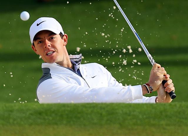 Rory McIlroy, of Northern Ireland, hits from the sand trap to the second green during practice for the Masters golf tournament Tuesday, April 8, 2014 in Augusta, Ga. (AP Photo/Atlanta Journal-Constitution, Curtis Compton)
