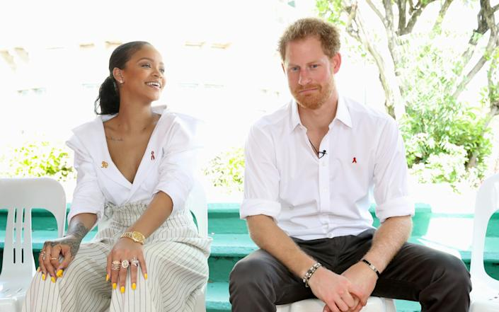 Prince Harry with pop star Rihanna in Barbados in 2016 - Getty