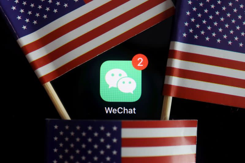 FILE PHOTO: The messenger app WeChat is seen among U.S. flags in this illustration picture
