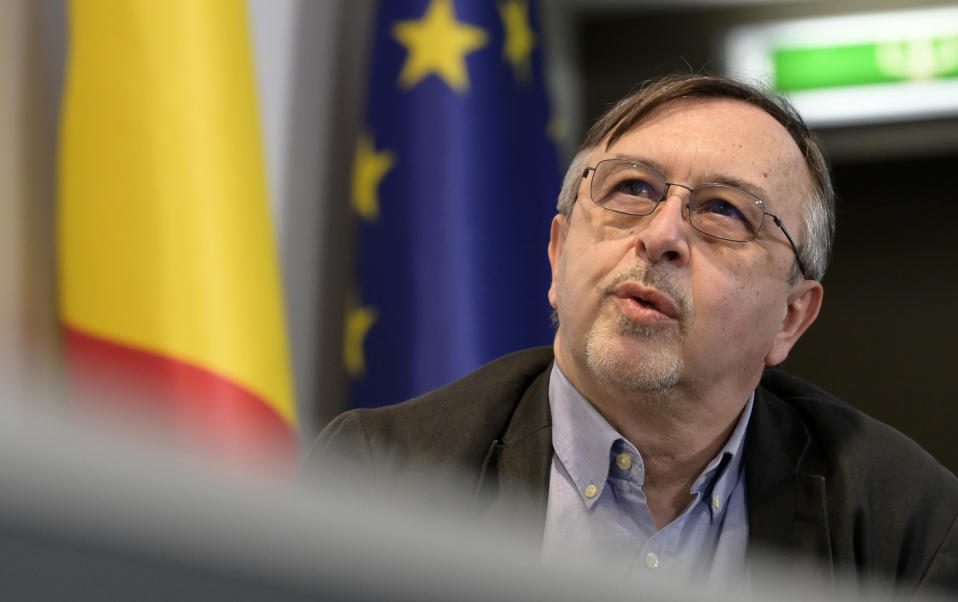 Dr. Yves Van Laethem speaks during a media conference at the prime minister's office in Brussels, Monday, Feb. 22, 2021. The government on Monday presented scientific projections of the spread of the COVID-19 pandemic in Belgium, indicating it would be very risky to extensively loosen the current restrictions over the coming weeks. (Philip Reynaers, Pool via AP)