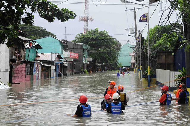 Rescue workers use ropes to rescue stranded residents of Justinville, Bacoor Cavite on 07 August 2012. The Habagat continues to bring scattered rain showers that caused flood in some parts of Cavite. (Angela Galia, NPPA images)