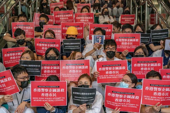 Members of the medical profession gather to protest against Hong Kong police brutality at Queen Elizabeth Hospital on August 13, 2019 in Hong Kong, China. (Photo: Philip Fong/NurPhoto via Getty Images)