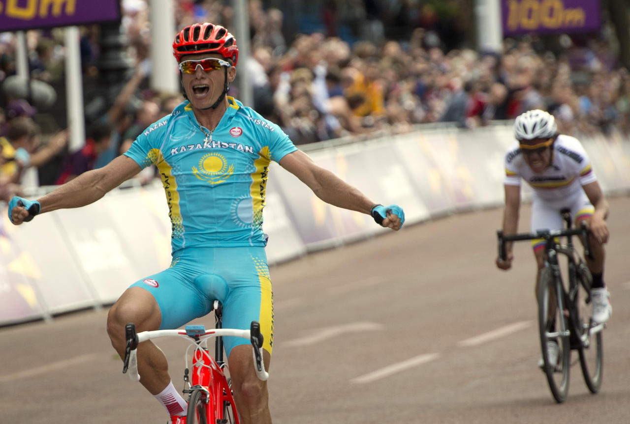 Kazakhstan's Alexandre Vinokourov (L) celebrates as he crosses the finish line after winning the men's cycling road race event in London during the London 2012 Olympic games on July e28, 2012.  AFP PHOTO / ODD ANDERSENODD ANDERSEN/AFP/GettyImages