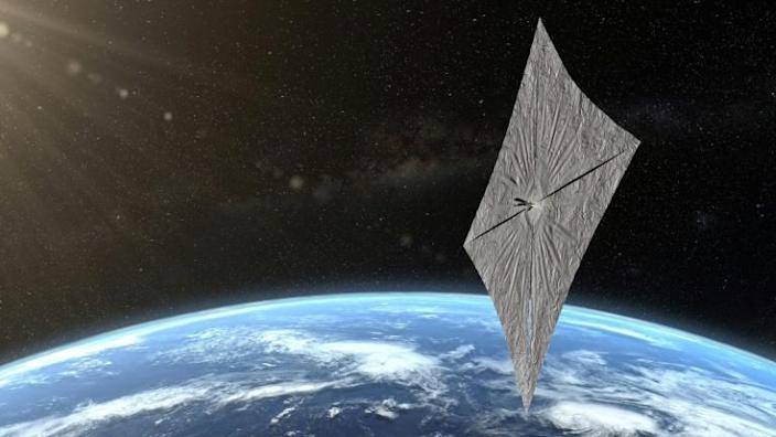 An artist's concept of LightSail 2 is depicted above Earth in this image released by the Planetary Society (AFP Photo/Josh Spradling)