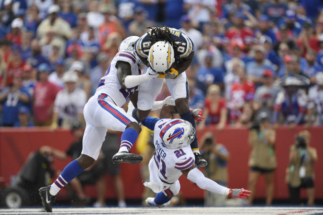 <p>Los Angeles Chargers' Mike Williams, top, catches the ball for a touchdown during the first half of an NFL football game against the Buffalo Bills, Sunday, Sept. 16, 2018, in Orchard Park, N.Y. (AP Photo/Adrian Kraus) </p>
