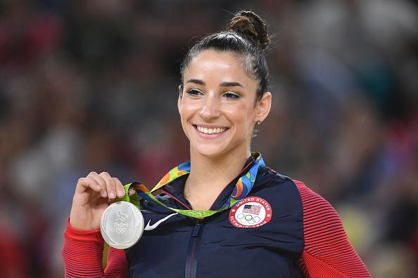 U.S. gymnast Alexandra Raisman celebrates on the podium of the women's floor event final of the Artistic Gymnastics at the Olympic Arena during the Rio 2016 Olympic Games in Rio de Janeiro on August 16, 2016. | AFP—Getty Images