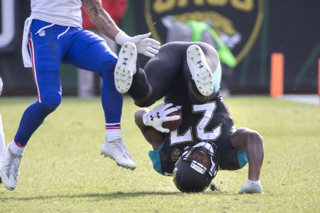 <p>Jacksonville Jaguars running back Leonard Fournette (27) is tackled by the Buffalo Bills defense during the second half of an NFL wild-card playoff football game, Sunday, Jan. 7, 2018, in Jacksonville, Fla. Jaguars beat the Bills 10-3. (AP Photo/Stephen B. Morton) </p>