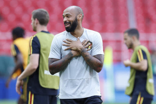 Belgium first assistant coach Thierry Henry smiles during Belgium's official training ahead of the group G match between Belgium and Tunisia at the 2018 soccer World Cup in the Spartak Stadium in Moscow, Russia, Friday, June 22, 2018. (AP Photo/Hassan Ammar)