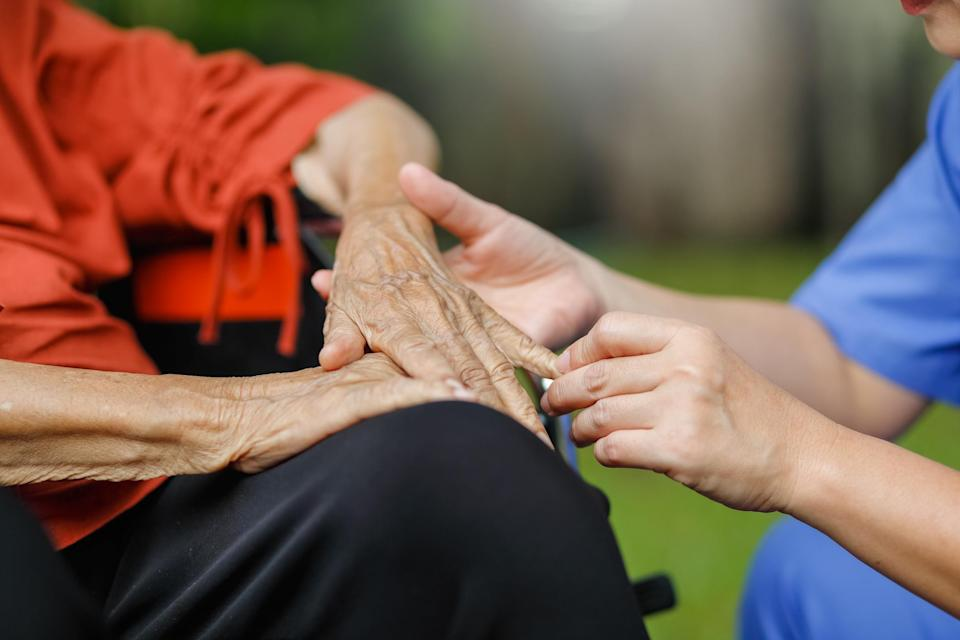 elderly woman talking with caregiver