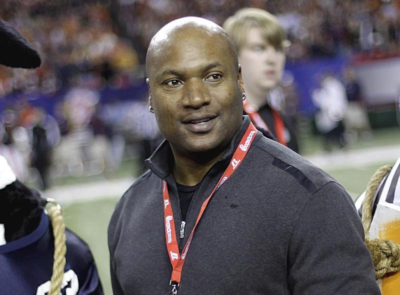 FILE - In this Dec. 31, 2011 file photo, former Auburn player Bo Jackson attends the Chick-fil-A Bowl NCAA college football game between Auburn and Virginia in Atlanta. Jackson will be honored at the 2013 MLB Beacon Awards Luncheon next month. Major League Baseball announced Thursday, July 25, 2013 that Aretha Franklin and Jackson will receive awards Aug. 24 at the Chicago Marriott Magnificent Mile before the annual Civil Rights Game. The game will be played between the Chicago White Sox and the Texas Rangers at the U.S. Cellular Field. (AP Photo/David Goldman, File)
