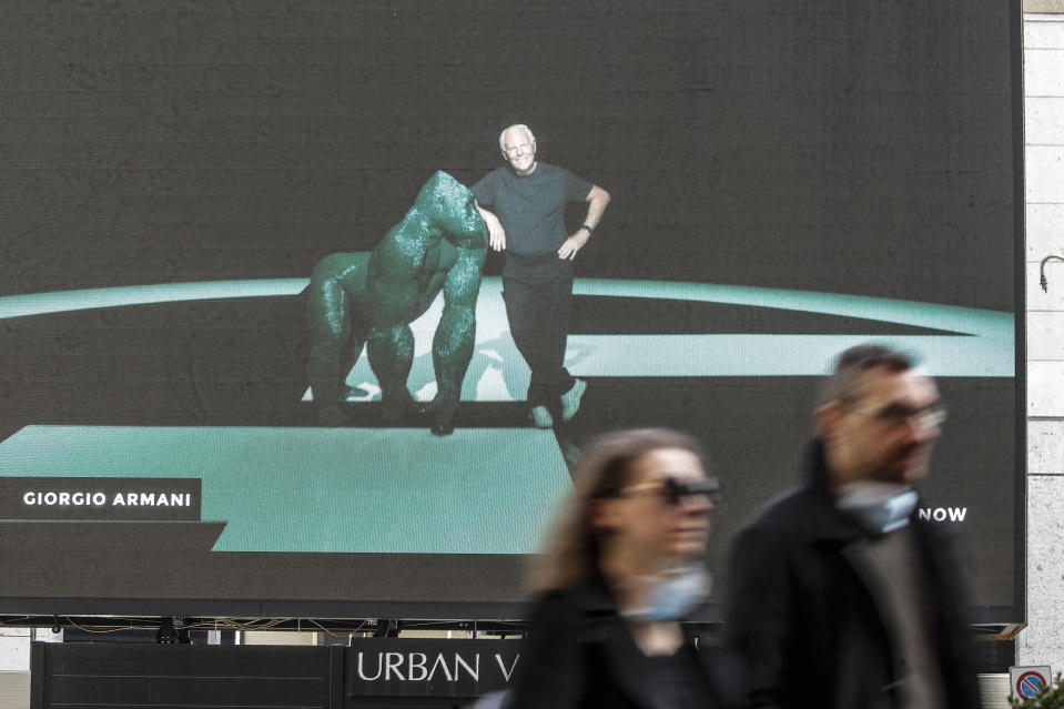 A giant screen streams a Giorgio Armani fashion live show presenting the women's Fall Winter 2021-22 collection, unveiled during the Fashion Week in Milan, Italy, Saturday, Feb. 27, 2021. (AP Photo/Luca Bruno)