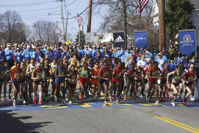 Athletes from the elite women field start during the 118th running of the Boston Marathon in Hopkinton, Massachusetts, April 21, 2014. Some 36,000 athletes will run in the 118th Boston Marathon on Monday in the first running of the race since last year's bombing attack, with top ranked Kenyan and Ethiopian runners among the second-largest field in the race's history. REUTERS/Dominick Reuter (UNITED STATES - Tags: SPORT ATHLETICS)