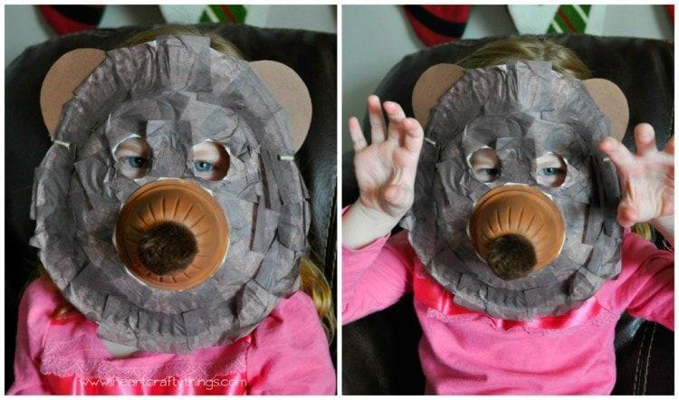 """<p>Made with a paper plate, plastic fruit cup, brown paint, and brown tissue paper squares, this bear mask takes barely any effort to put together. </p><p><strong><em>Get the tutorial at <a href=""""https://iheartcraftythings.com/paper-plate-bear-mask-craft.html"""" rel=""""nofollow noopener"""" target=""""_blank"""" data-ylk=""""slk:I Heart Crafty Things"""" class=""""link rapid-noclick-resp"""">I Heart Crafty Things</a>. </em></strong></p>"""