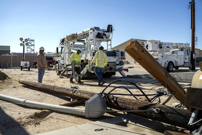 FILE - In this July 10, 2019 file photo provided by the U.S. Navy, civilian workers assigned to Naval Air Weapons Station China Lake repair damaged base infrastructure after multiple earthquakes occurred at the base, nearby Ridgecrest and a wide area of Southern California. Scientists say the earthquakes that hammered the Southern California desert near the town of Ridgecrest last summer involved ruptures on a web of interconnected faults and increased strain on a major nearby fault that has begun to slowly move. (Mass Communication Specialist 1st Class Arthurgwain L. Marquez/U.S. Navy via AP,File)