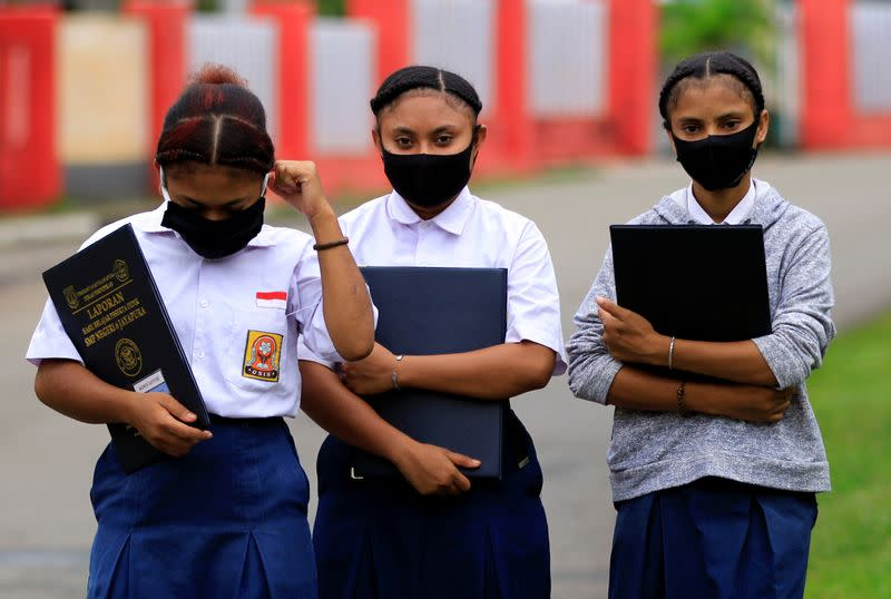 Students wear protective masks at a school amid coronavirus disease (COVID-19) pandemic in Jayapura