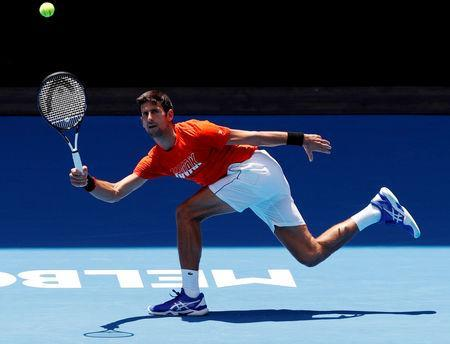 Tennis - Australian Open - Melbourne Park, Melbourne, Australia - January 10, 2019 - Serbia's Novak Djokovic at a practice match against Britain's Andy Murray. REUTERS/Kim Kyung-Hoon