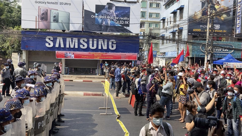 In this image made from video, riot police block the road to prevent protesters from marching forward Saturday, Feb. 6, 2021, in Yangon, Myanmar. The military authorities in charge of Myanmar broadened a ban on social media following this week's coup, shutting access to Twitter and Instagram, while street protests continued to expand Saturday as people gathered again to show their opposition to the army takeover.(AP Photo)