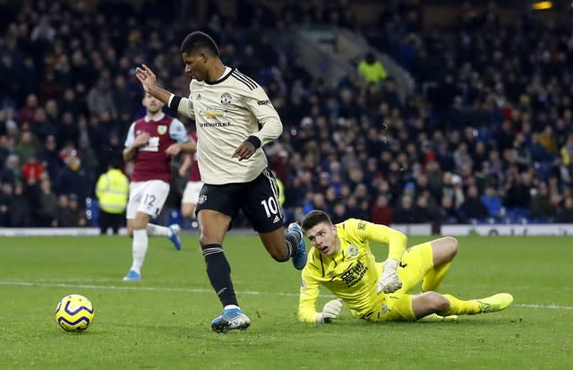 Marcus Rashford has spoken of the struggles he faced growing up in Manchester (Martin Rickett/PA)