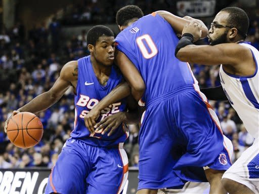 Boise State's Derrick Marks, left, tries to get around teammate Ryan Watkins (0) and Creighton's Gregory Echenique, right, during the first half of an NCAA college basketball game in Omaha, Neb., Wednesday, Nov. 28, 2012. (AP Photo/Nati Harnik)