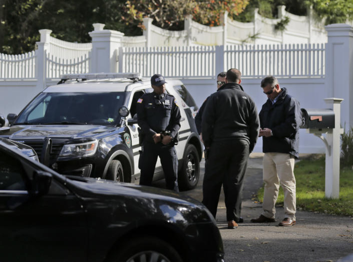 """<p>Police officers stand in front of property owned by Hillary and Bill Clinton in Chappaqua, N.Y., Wednesday, Oct. 24, 2018. A U.S. official says a """"functional explosive device"""" was found at the Clinton's suburban New York home. (Photo: Seth Wenig/AP) </p>"""