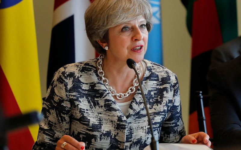 Theresa May speaking during a session on action to end forced labor, modern slavery and human trafficking in 2017 - Julie Jacobson/AP