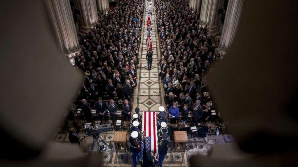 PHOTO: The flag-draped casket of former President George H.W. Bush arrives for a State Funeral at the National Cathedral, Dec. 5, 2018 in Washington, D.C. (Andrew Harnik/Pool via Getty Images)